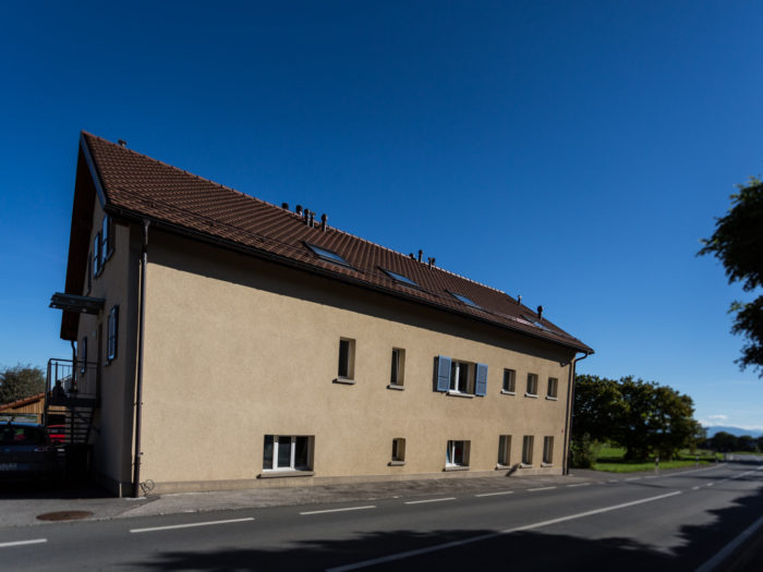 Création de 4 appartements dans une maison villageoise à Cottens