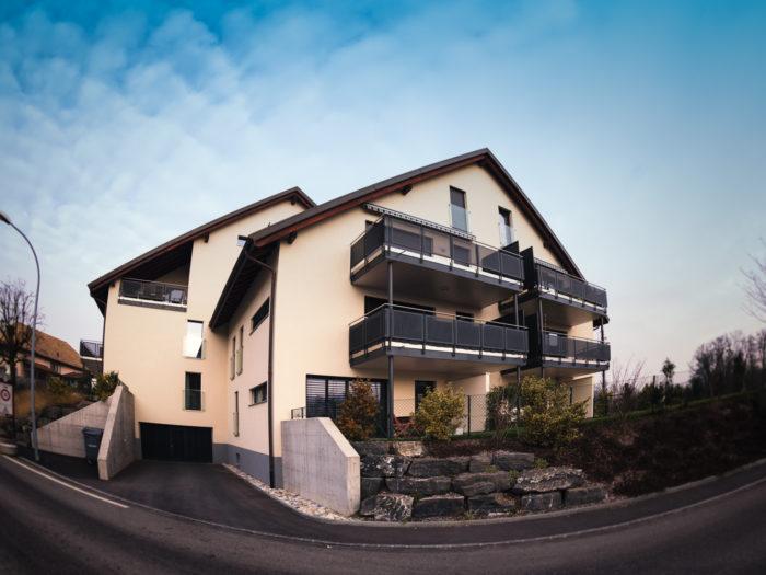 Immeuble de 18 appartements avec parking souterrain de 29 places à Monnaz